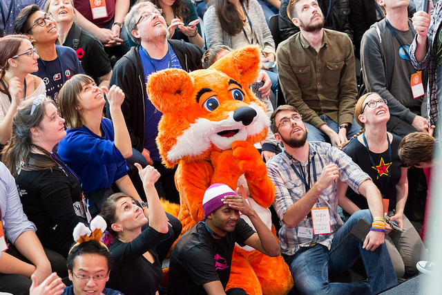 Group of visitors with Mozilla fox at MozFest 2015